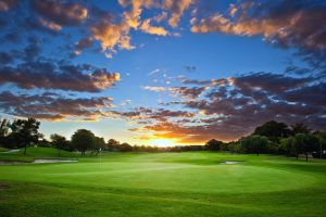 Sunset over golf course with stunning cloud formation and colors